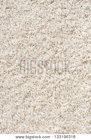 Background of long white rice. Close up top view high resolution product.