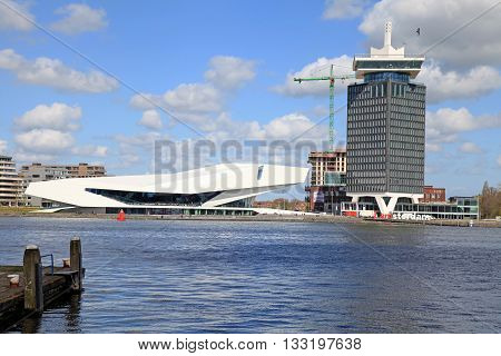 AMSTERDAM, NETHERLANDS - MAY 3, 2016: EYE Film Institute and Overhoeks Tower in Amsterdam, Netherlands. EYE Film Institute includes a cinematography museum.