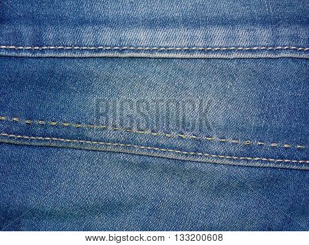 Denim blue color with overdue seams, close up