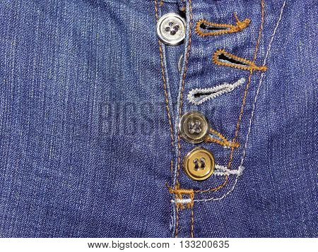 Denim blue, with buttons of gold color