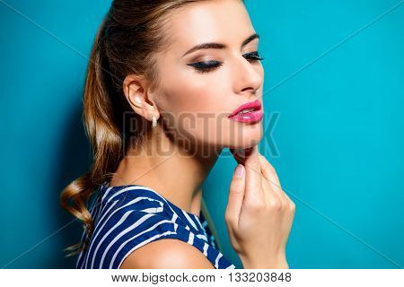 Make-up concept. Close-up portrait of a beautiful young woman with elegant make-up. Beauty, fashion. Cosmetics.
