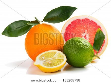Citrus fruits. Orange lime grapefruit and lemon with green leaves isolated on white background.