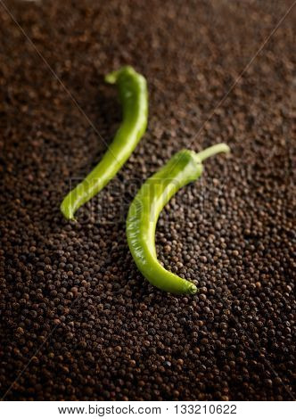 image of closeup green peppers on black peppercorns