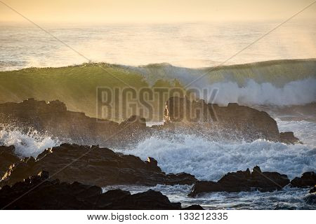 Waves crashing over rocks from the ocean's incoming morning tide. Photo taken at Crescent Head - on the mid-North Coast of New South Wales, Australia.