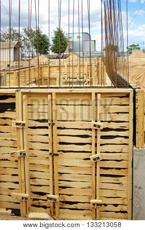 the formwork of wooden boards for pouring concrete foundations in construction