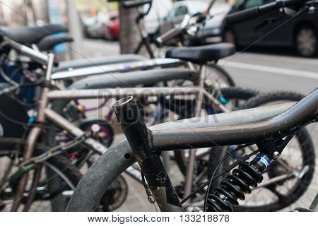 rotten bicycle cruiser without seat on parking