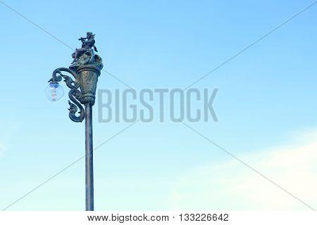 Light pole on blue skies background .