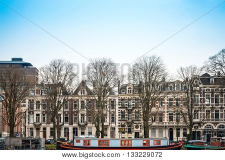 Amsterdam, Netherlands.-March 16, 2016 : Beautiful view of Amsterdam canals with bridge and typical dutch houses. Amsterdam, Netherlands