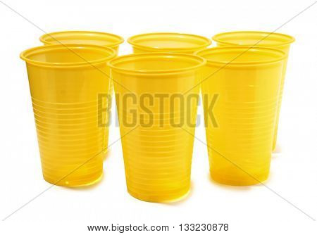 Yellow plastic glasses on a white background