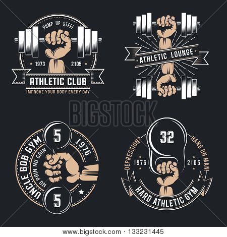 Vintage athletic logo- hand with dumbbell and kettlebell on a black background.