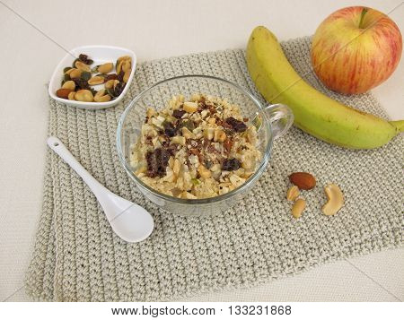 Crumble mug cake with banana, apple, chocolate and nuts
