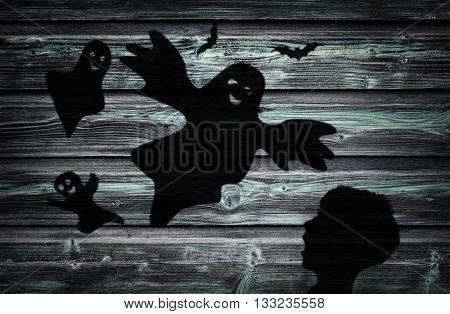 The Black Shadow Of frightened Child and Ghosts On The Wooden Wall.