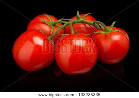 A few tomatoes isolated on black background
