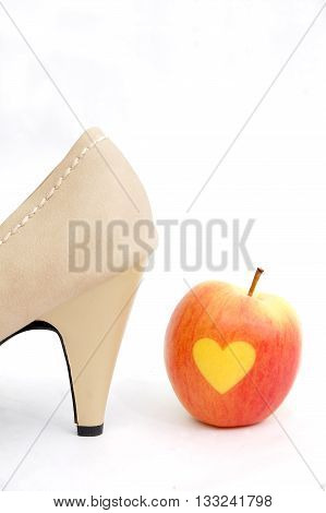 picture of a sexy beige female shoes on a white background.