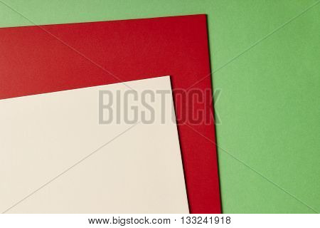 Colored cardboards background in green red beige tone. Copy space. Horizontal