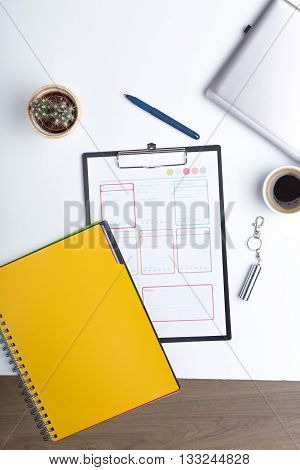 Office table with ballpoint pen and clipboard. Office desk table with clipboard, supplies, coffee cup, pen or pencil, USB card. Top view with copy space.