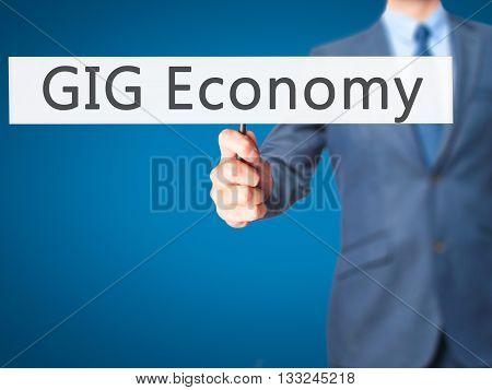 Gig Economy - Businessman Hand Holding Sign