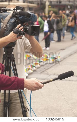 TV interview. Journalist holding a microphone conducting an TV or radio interview