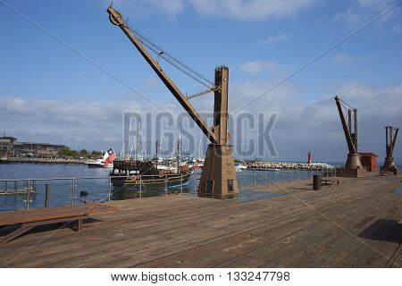 ANTOFAGASTA, CHILE - MAY 16, 2016: Historic pier in the city of Antofagasta in Chile. from where the produce from nitrate mining in the 18th and 19th centuries was shipped around the world.