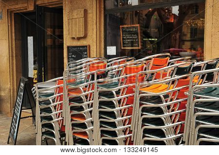 Aix en Provence France - april 21 2016 : pile of chairs in front of a restaurant