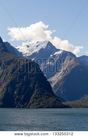 Mountains wih snow cap on Fjorland coast New Zealand