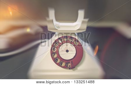 SCIENCE MUSEUM, LONDON - FEBRUARY 08, 2016: Blurry edges around close up of old telephone with rotary dialer and receiver off the hook. February 08, 2016 in London, UK.