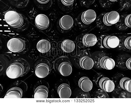 Glass bottles cover background in black and white