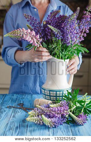 Woman Florist Creating A Bouquet