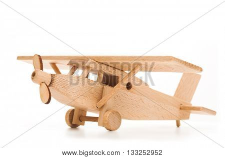 Retro wooden airplane isolated on white background. Travel concept