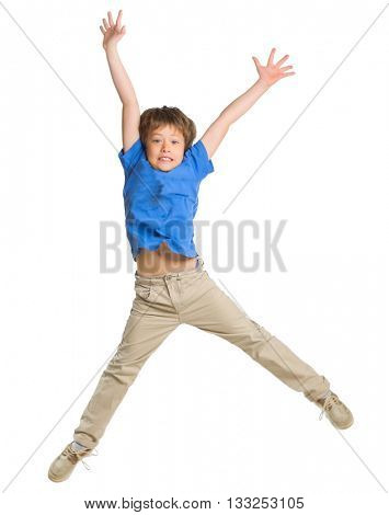 Jumping little boy isolated on white