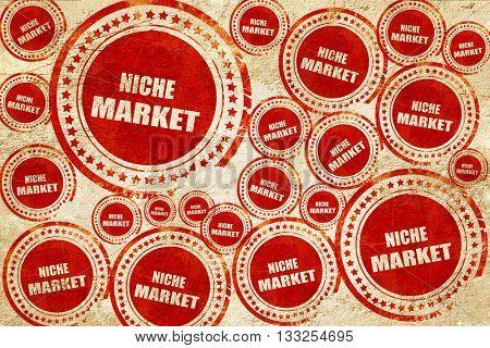 niche market, red stamp on a grunge paper texture
