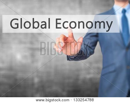 Global Economy - Businessman Hand Pressing Button On Touch Screen Interface.