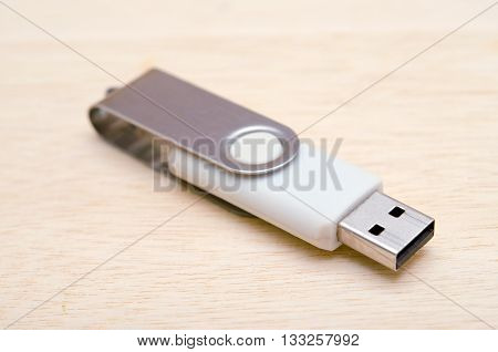 USB stick or USB thumb drive isolated on wooden board