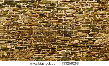 Old Cracked and Grinded Down Bricks Wall with Concrete as Background Outdoors