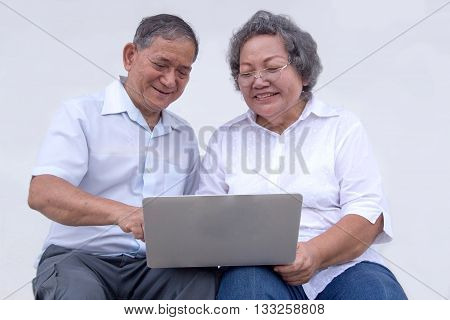 close up old generation use laptop for learning
