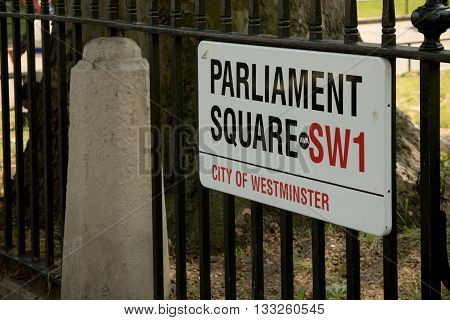 London United Kingdom - June 5th 2016: Sign for Parliament Square City of Westminster London. This square is home to the Palace of Westminster the home of the British Parliament.