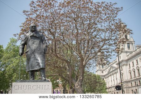 London United Kingdom - June 5th 2016: Statue of Winston Churchill standing in Parliament Square opposite the Palace of Westminster the seat of the British Parliament.