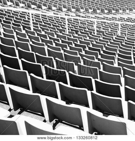 Rhythm of stadium seats. Black and white imade