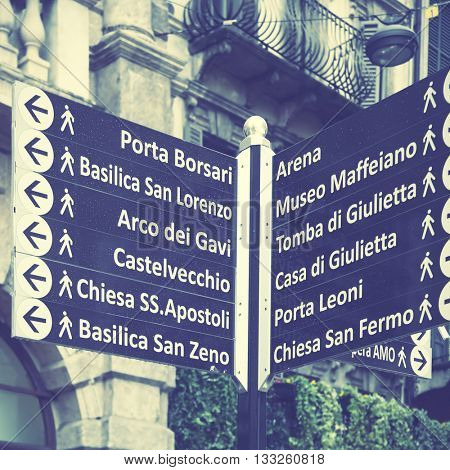 Signpost with landmarks of Verona, Italy. instagram style filtered image
