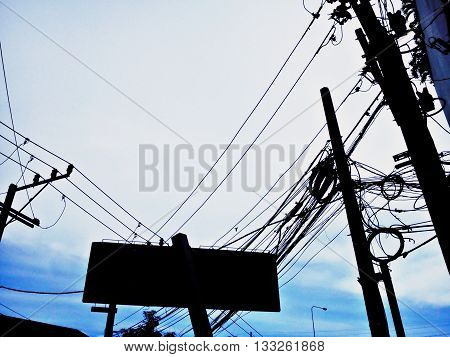 Style power lines communication lines and billboards in the downtown clutter