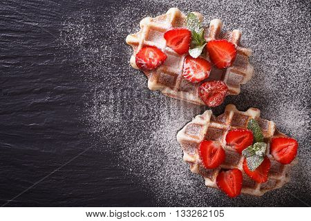 Liege Waffles With Fresh Strawberries, Powdered Sugar Closeup On The Slate. Horizontal Top View