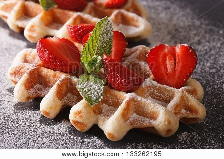 Freshly Baked Waffles With Strawberries Close-up On The Slate. Horizontal