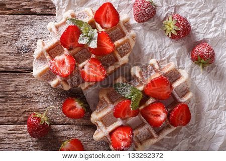 Rustic Waffles With Strawberries, Powdered Sugar And Mint Closeup. Horizontal Top View