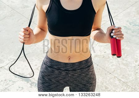Close-up Of Sporty Girl With A Skipping Rope In Hands On A Sunny Morning