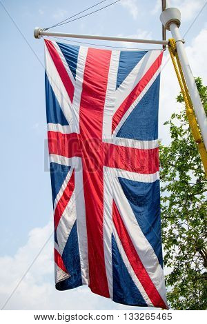 London United Kingdom - June 5th 2016: The UK's national flag the Union Flag also known as the Union Jack flying along The Mall London UK