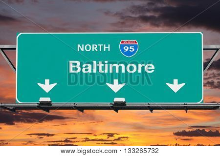 Interstate 95 to Baltimore Highway Sign with Sunrise Sky