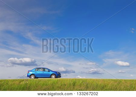 New car parked by the side of a lonely road in rural country