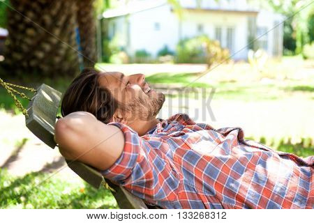Attractive Man Lying Down In Hammock In Back Yard