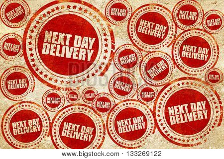 next day delivery, red stamp on a grunge paper texture
