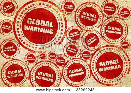 global warming, red stamp on a grunge paper texture